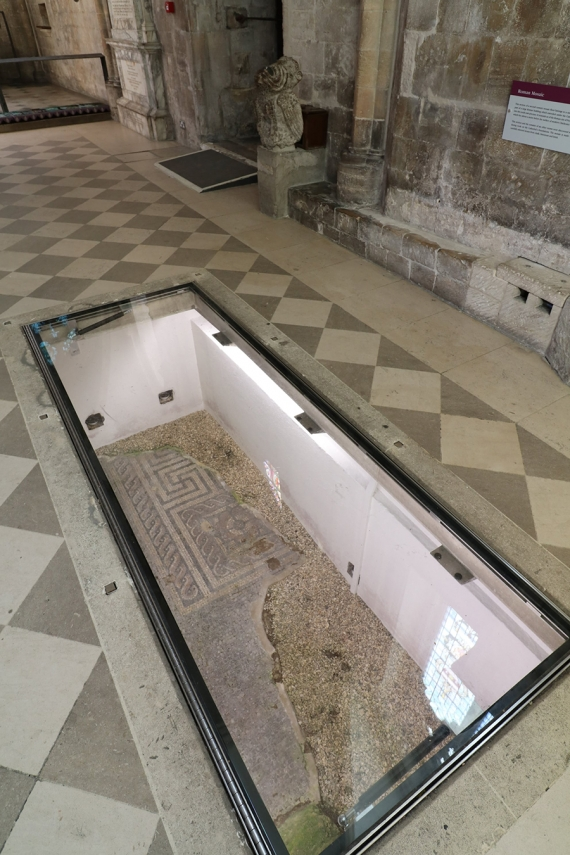 Hinged glass floor panel installed in Chichester Cathedral to protect Roman mosaic