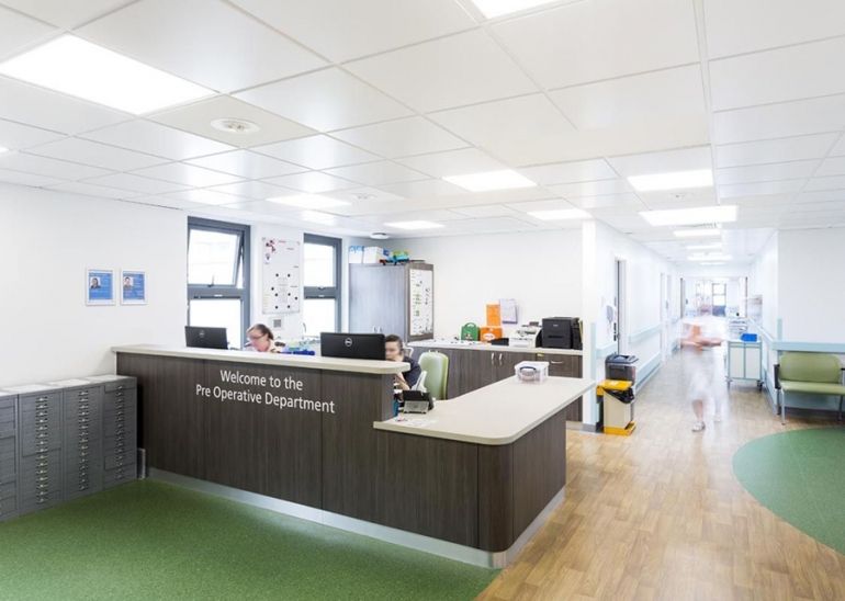 Armstrong PCM Ceilings help a new health unit keep its Cool